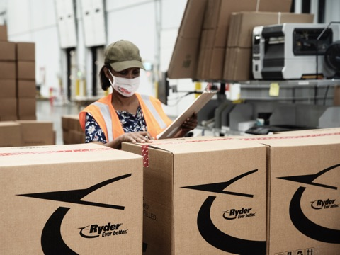Worker inspecting boxes